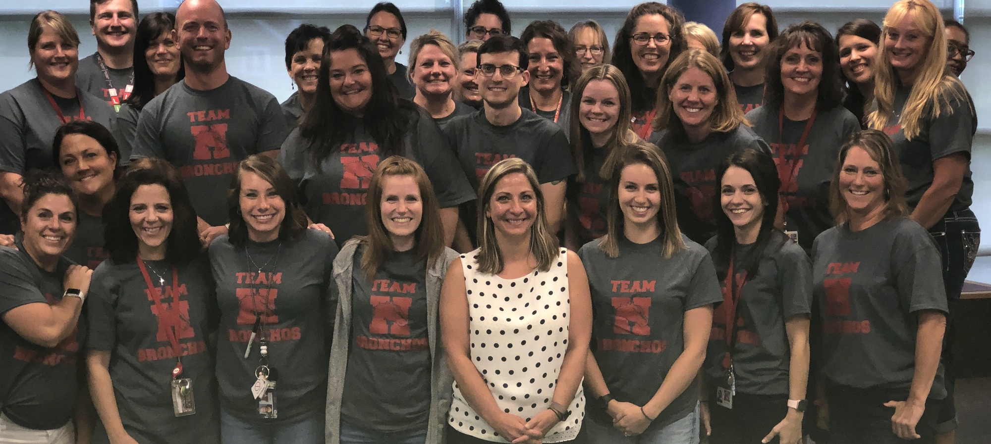 Holly elementary staff in their Team Bronchos shirts