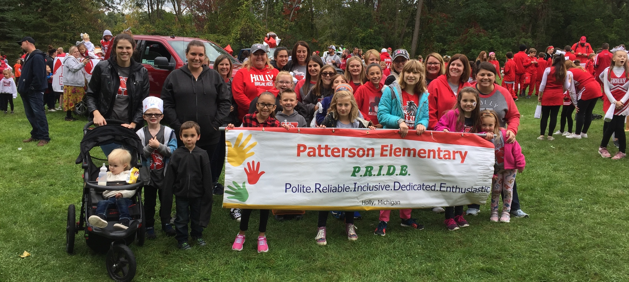 Patterson Pride banner with staff, students and parents