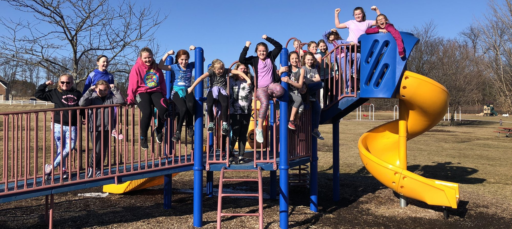 Patterson Girls Running Club posing on the play structure