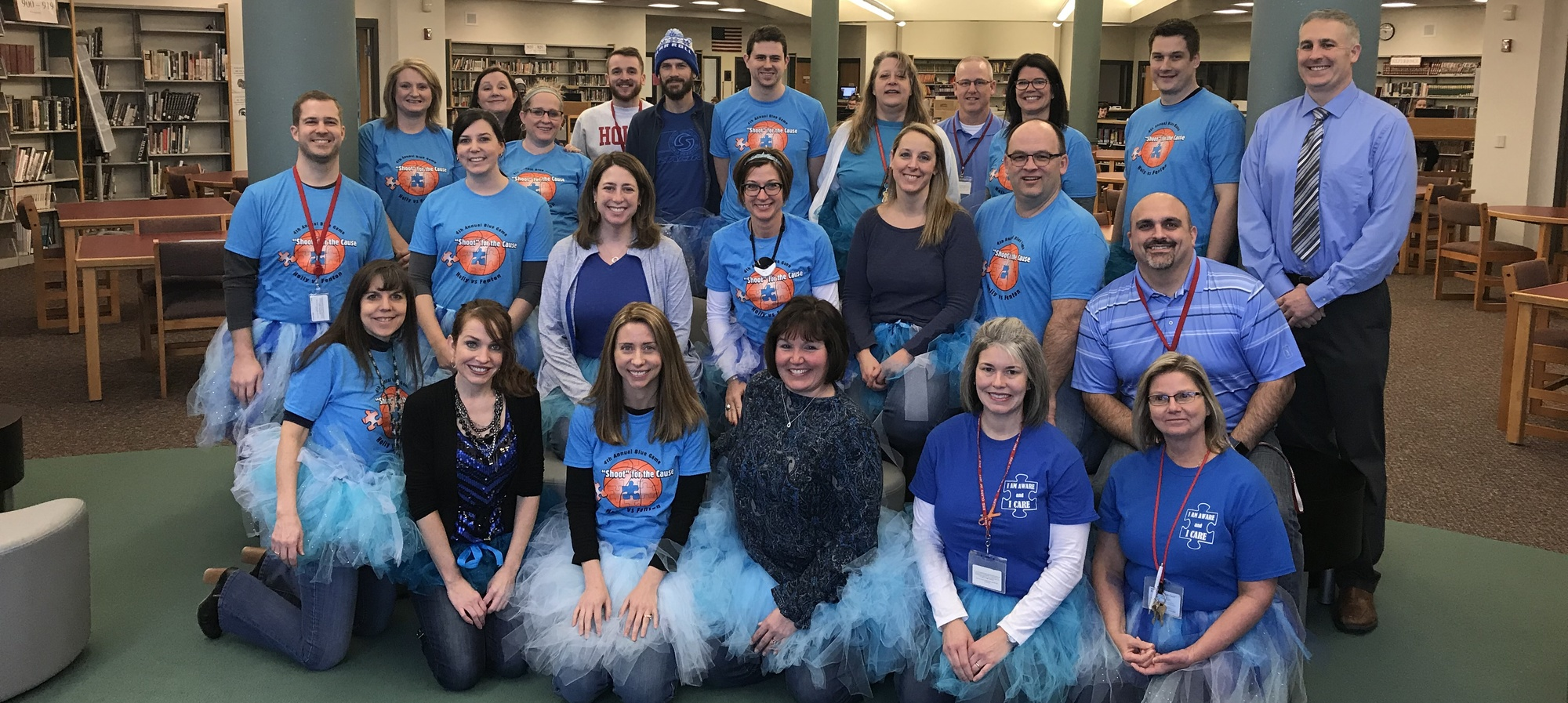 HHS staff supporting Autism Awareness wearing their blue shirts and blue tutus
