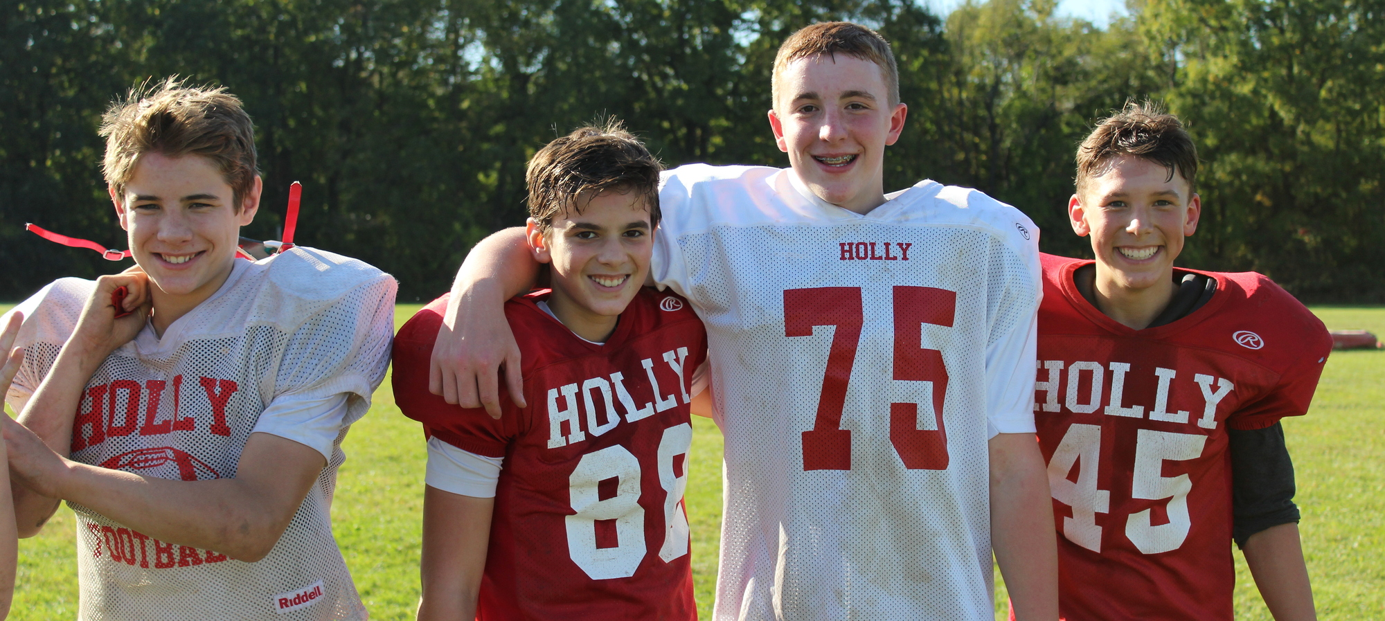 Four Middle school football players