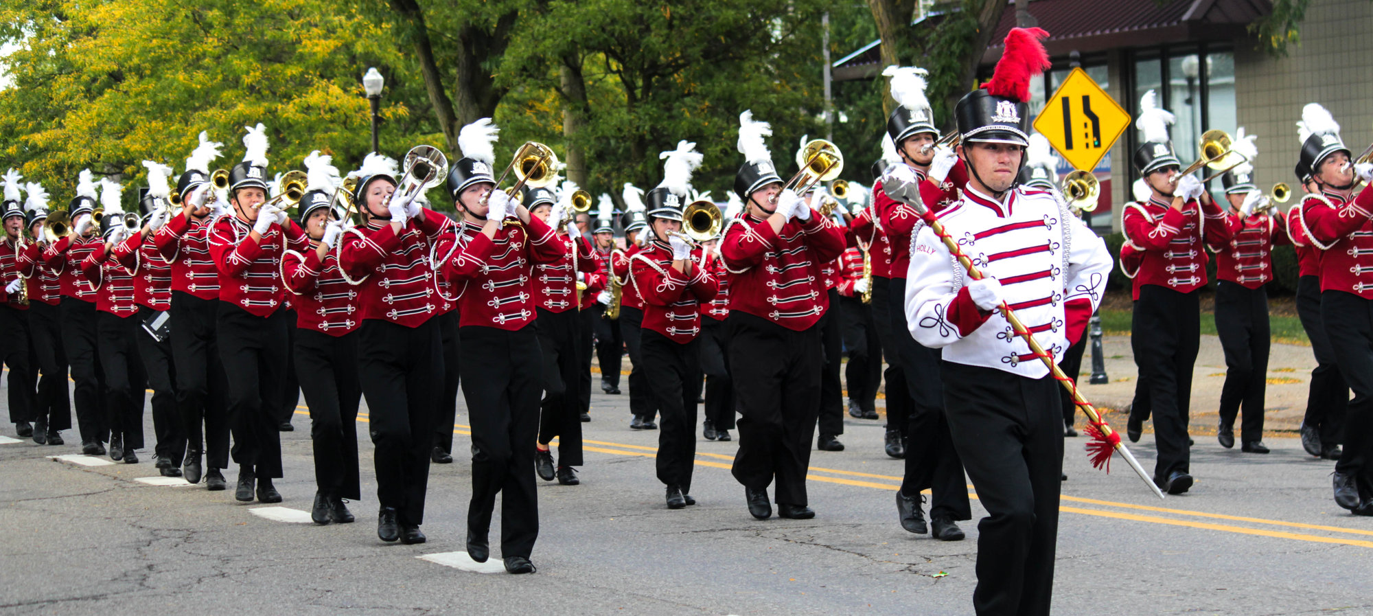 Holly marching band during the homecoming parade