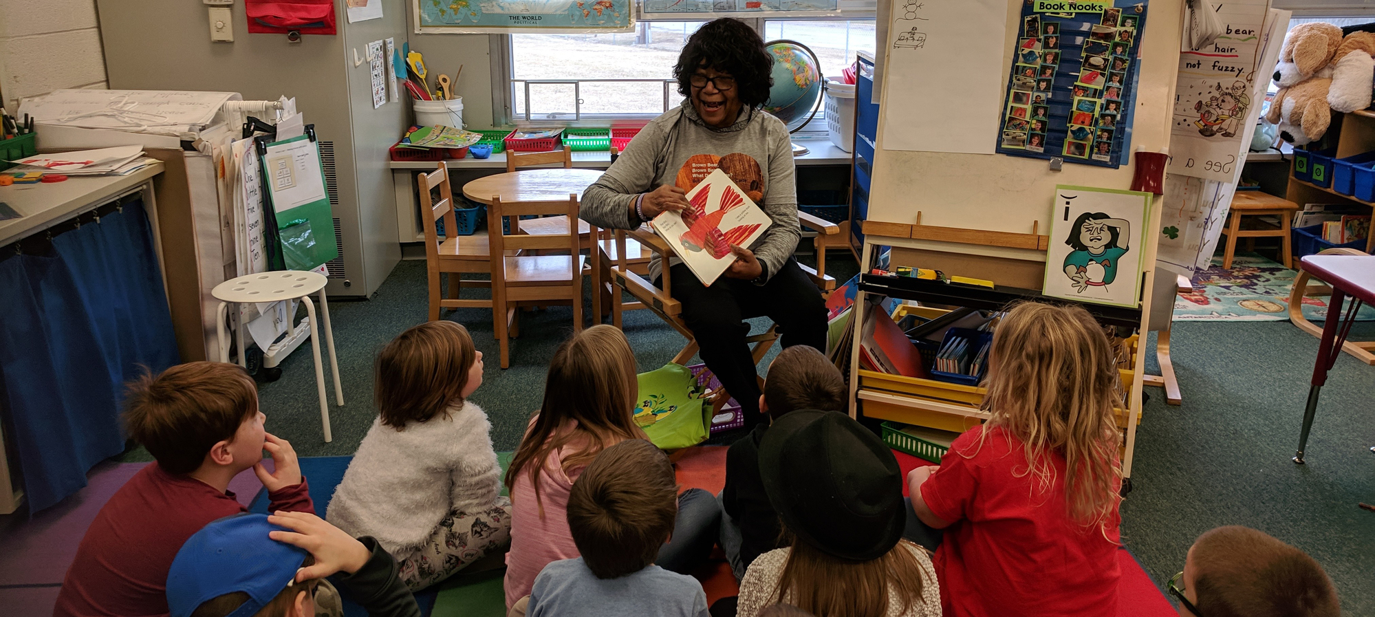 Mrs. Blair reading to students at Holly elementary