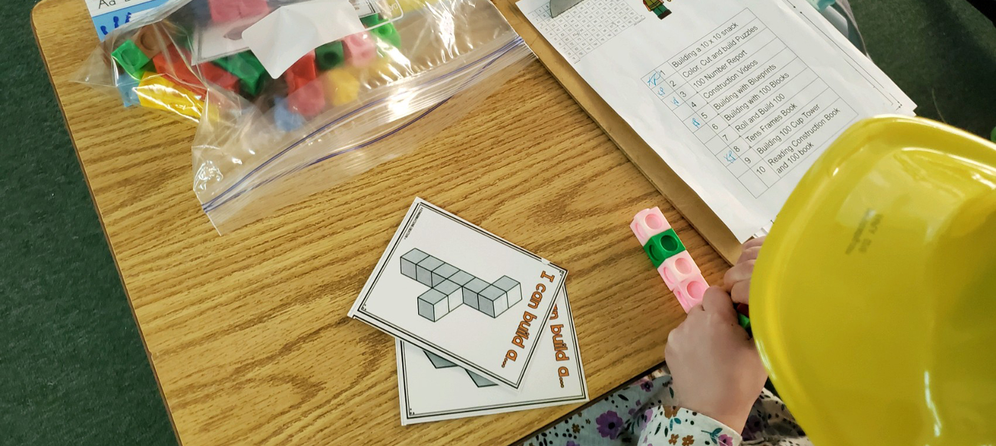 Girl working with 10 x 10 Construction blocks