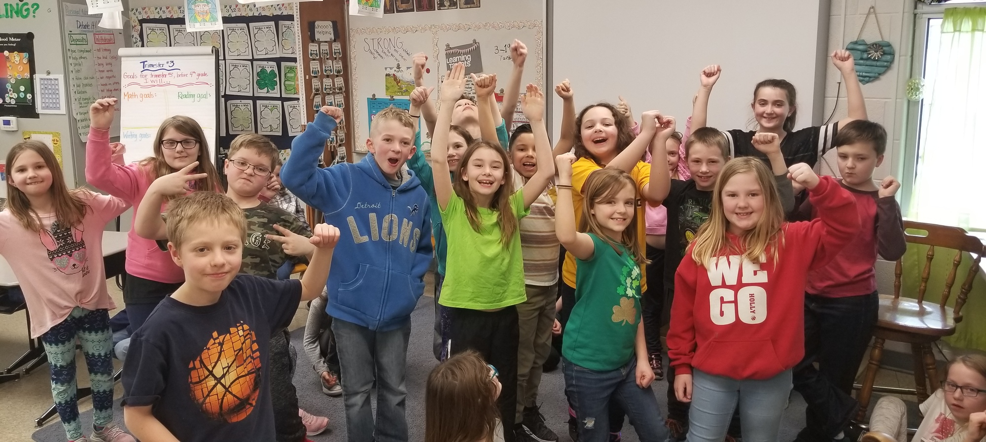 Third grade students at Davisburg standing and showing their I'm Strong faces.