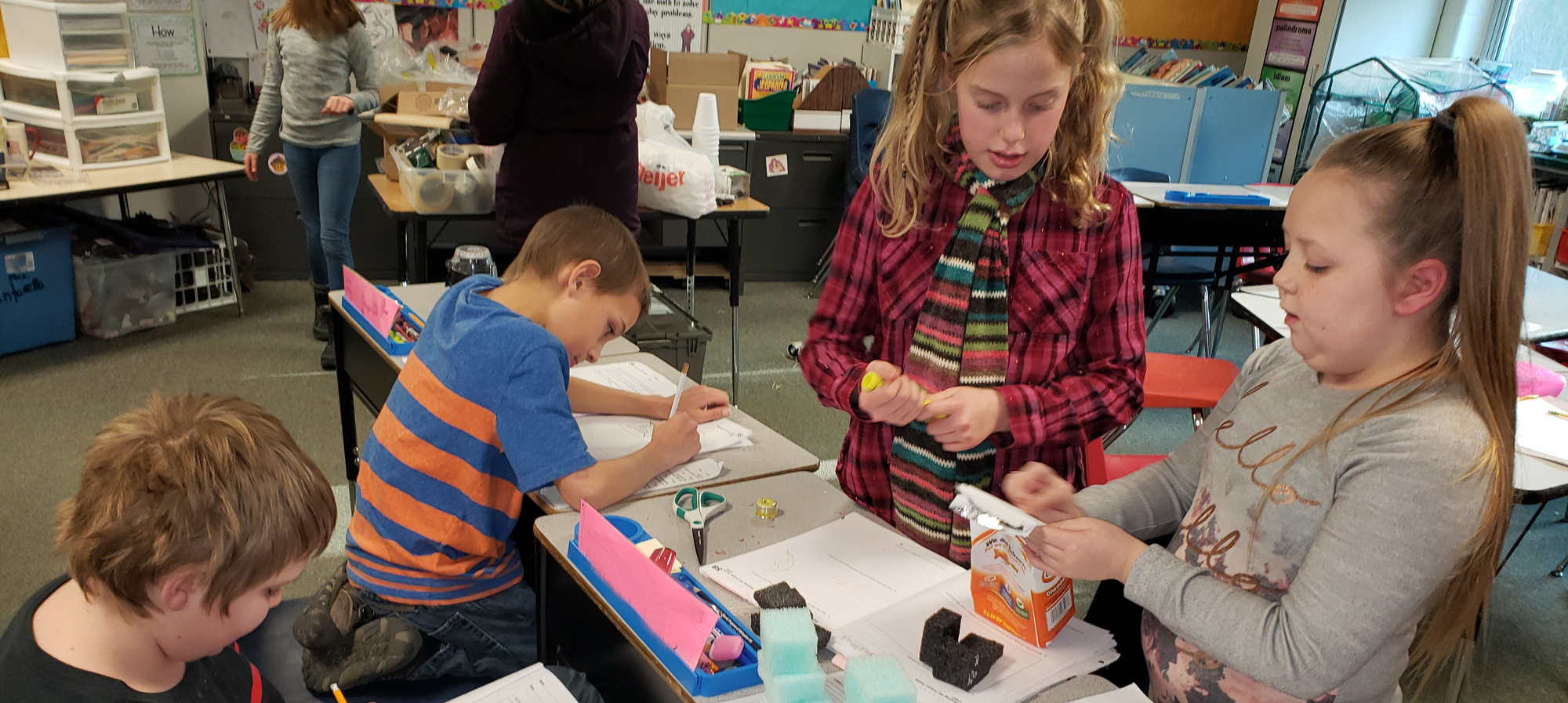 Students working in classroom on a project