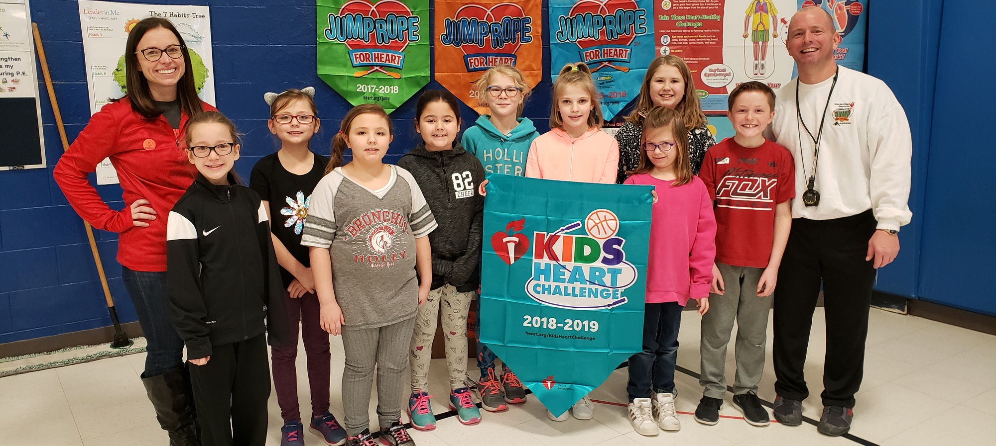Students with Jump Rope for Heart banner