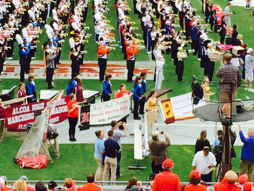 Band members at the Outback Bowl holding sign for Holly Band