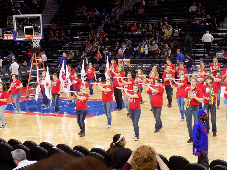 Band members performing at a Detroit Pistons Game